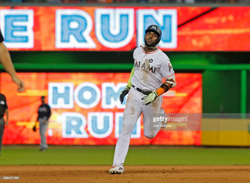 Marcell Ozuna #13 of the Miami Marlins runs the bases after hitting a seventh-inning solo home run against the Atlanta Braves at Marlins Park on October 1, 2017 in Miami, Florida.