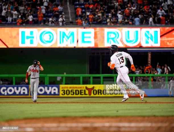 Marcell Ozuna of the Miami Marlins runs the bases after hitting a home run during the Opening Day game against the Atlanta Braves at Marlins Park on...