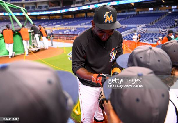 Marcell Ozuna of the Miami Marlins signs autographs for fans before the game against the Atlanta Braves at Marlins Park on April 12 2017 in Miami...