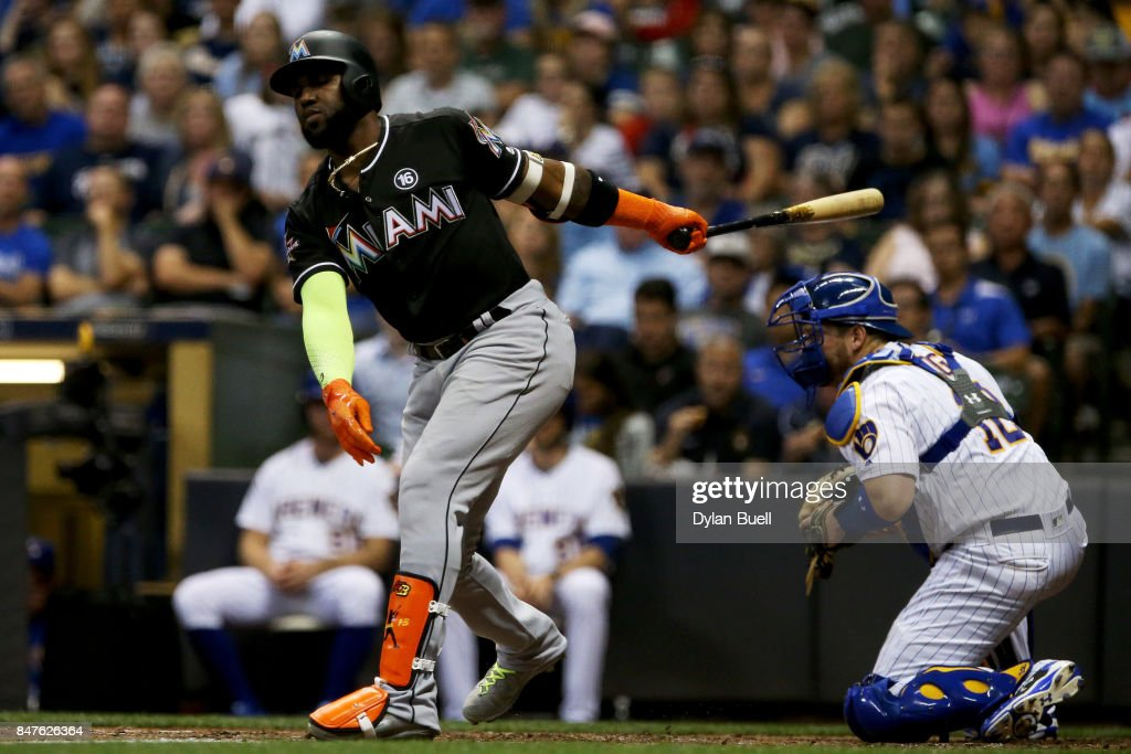 Marcell Ozuna #13 of the Miami Marlins strikes out in the third inning against the Milwaukee Brewers at Miller Park on September 15, 2017 in Milwaukee, Wisconsin.