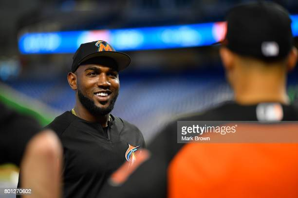 Marcell Ozuna of the Miami Marlins visits with the Miami Marlins top three draft picks Trevor Rogers Brian Miller and Joe Dunand visit Marlins Park...
