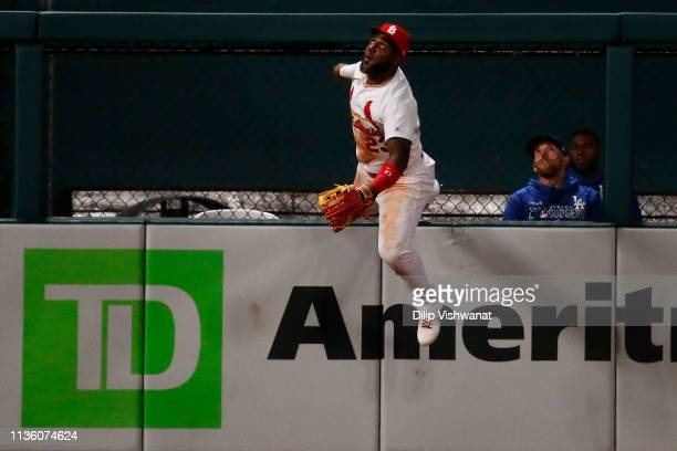 Marcell Ozuna of the St Louis Cardinals attempts to catch a fly ball against the Los Angeles Dodgers eighth inning at Busch Stadium on April 9 2019...