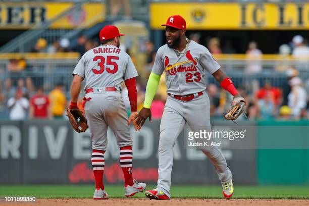 Marcell Ozuna of the St Louis Cardinals celebrates after defeating the Pittsburgh Pirates at PNC Park on August 5 2018 in Pittsburgh Pennsylvania