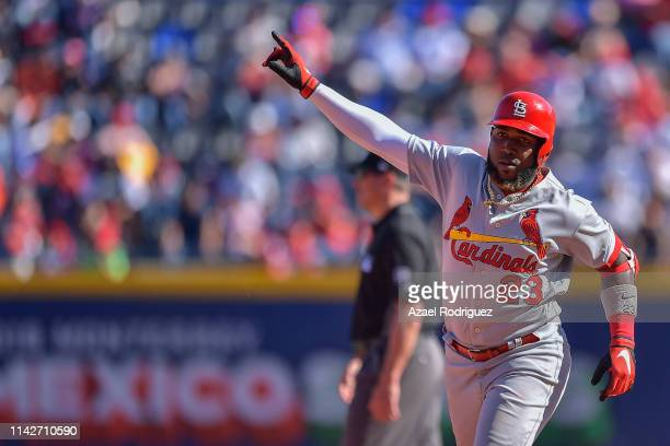 Marcell Ozuna of the St Louis Cardinals celebrates after hitting a home run on the seventh inning of the second game of the Mexico Series between the...