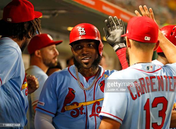 Marcell Ozuna of the St. Louis Cardinals celebrates after hitting a three run home run in the third inning against the Pittsburgh Pirates at PNC Park...