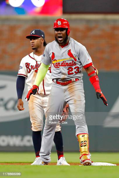 Marcell Ozuna of the St. Louis Cardinals celebrates after hitting a two-RBI double against the Atlanta Braves during the ninth inning in game one of...