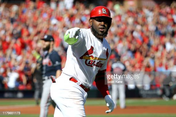 Marcell Ozuna of the St Louis Cardinals celebrates after hitting a solo home run against the Atlanta Braves during the first inning in game four of...