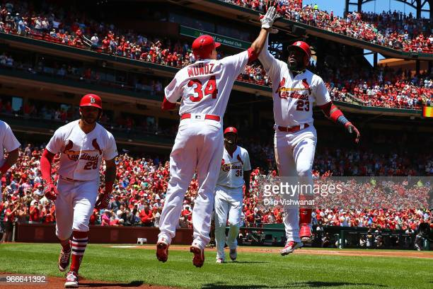 Marcell Ozuna of the St Louis Cardinals celebrates after hitting a grand slam against the Pittsburgh Pirates in the first inning at Busch Stadium on...