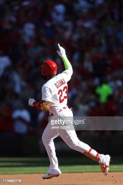 Marcell Ozuna of the St Louis Cardinals celebrates as he rounds first base after hitting his second solo home run of the game against the Atlanta...