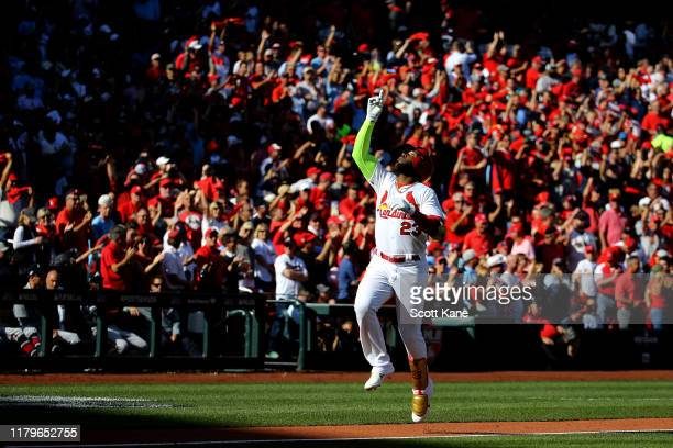 Marcell Ozuna of the St Louis Cardinals celebrates as he rounds third base after hitting his second solo home run of the game against the Atlanta...