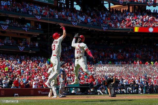 Marcell Ozuna of the St Louis Cardinals celebrates with Matt Carpenter of the St Louis Cardinals after hitting a tworun home run against the San...