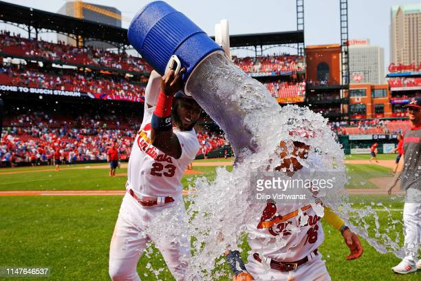 Marcell Ozuna of the St Louis Cardinals douses Kolten Wong of the St Louis Cardinals after beating the Chicago Cubs at Busch Stadium on June 2 2019...