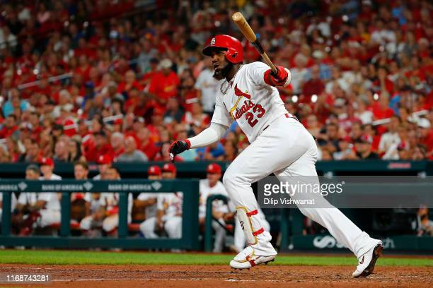 Marcell Ozuna of the St Louis Cardinals drives in two runs with a groundrule double against the Washington Nationals in the seventh inning at Busch...
