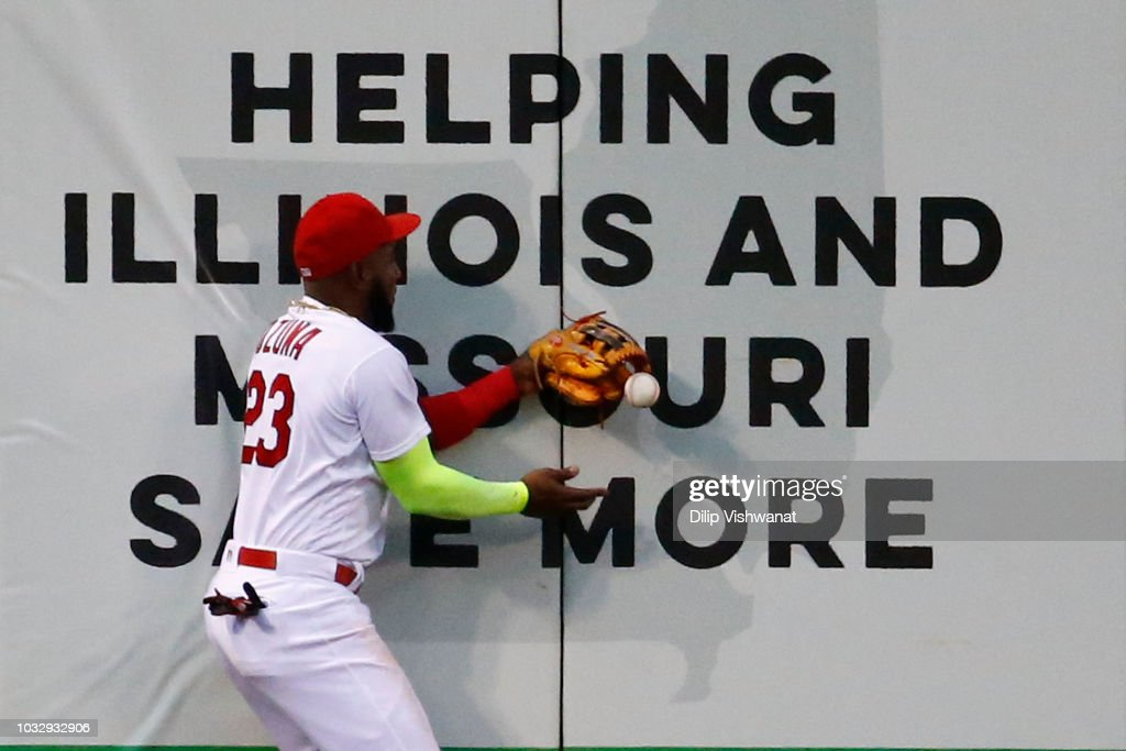 Marcell Ozuna #23 of the St. Louis Cardinals drops a fly ball against the Los Angeles Dodgers in the third inning at Busch Stadium on September 13, 2018 in St. Louis, Missouri.