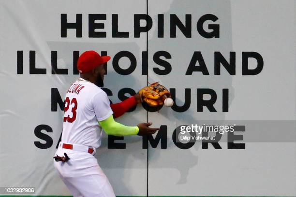 Marcell Ozuna of the St Louis Cardinals drops a fly ball against the Los Angeles Dodgers in the third inning at Busch Stadium on September 13 2018 in...