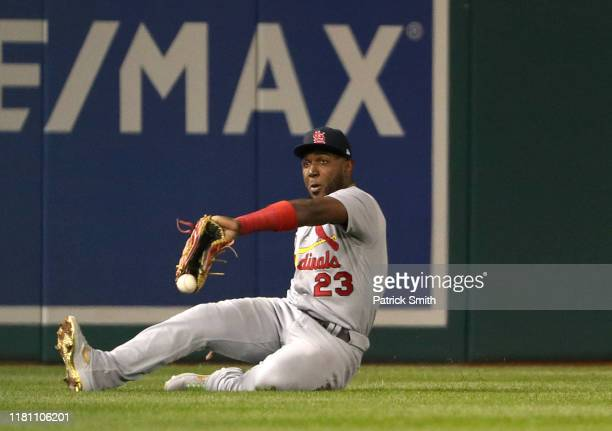 Marcell Ozuna of the St Louis Cardinals fails to make the catch on an RBI double by Anthony Rendon of the Washington Nationals in the third inning of...