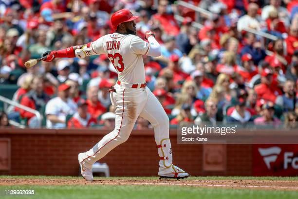 Marcell Ozuna of the St Louis Cardinals follows through on a threerun home run during the third inning against the Cincinnati Reds at Busch Stadium...