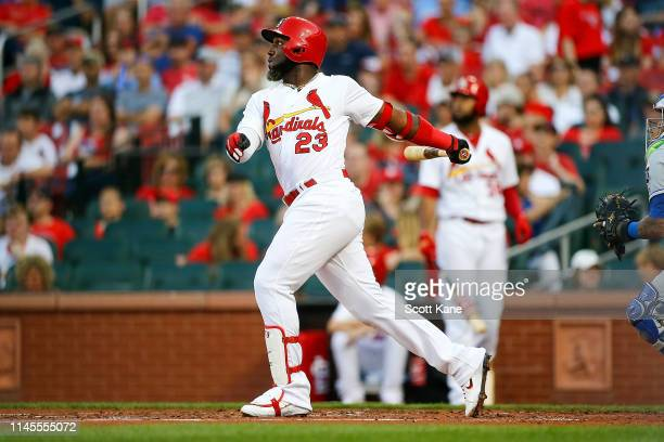 Marcell Ozuna of the St Louis Cardinals follows through on a threerun home run during the first inning of game two of a doubleheader against the...
