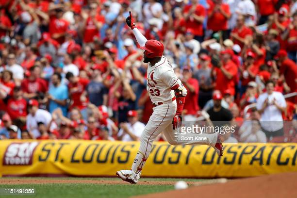 Marcell Ozuna of the St Louis Cardinals gestures skyward as he runs the bases after hitting a tworun home run during the sixth inning against the Los...