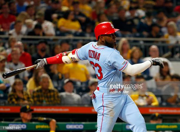 Marcell Ozuna of the St. Louis Cardinals hits a three run home run in the third inning against the Pittsburgh Pirates at PNC Park on September 7,...