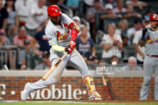 Marcell Ozuna of the St Louis Cardinals hits a twoRBI double against the Atlanta Braves during the ninth inning in game one of the National League...