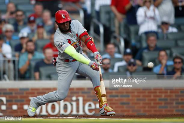 Marcell Ozuna of the St Louis Cardinals hits an RBI single against the Atlanta Braves during the first inning in game five of the National League...