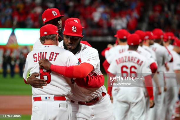 Marcell Ozuna of the St Louis Cardinals hugs manager Mike Shildt prior to Game 1 of the NLCS against the Washington Nationals at Busch Stadium on...