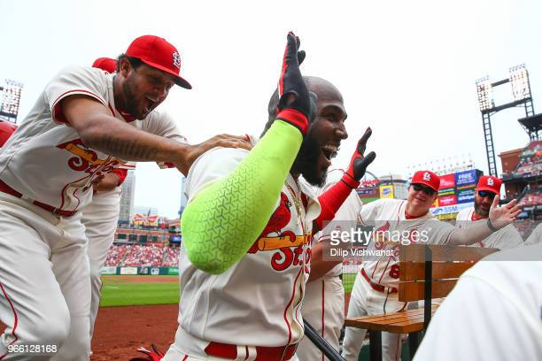 Marcell Ozuna of the St Louis Cardinals is congratulated by Jose Martinez of the St Louis Cardinals after hitting a home run against the Pittsburgh...