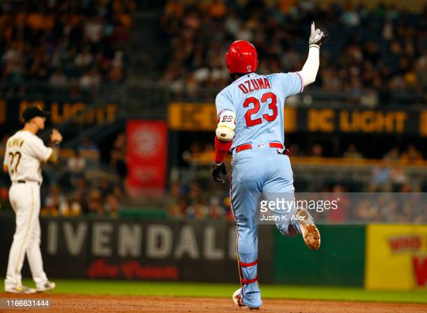Marcell Ozuna of the St. Louis Cardinals rounds second base after hitting a three run home run in the third inning against the Pittsburgh Pirates at...