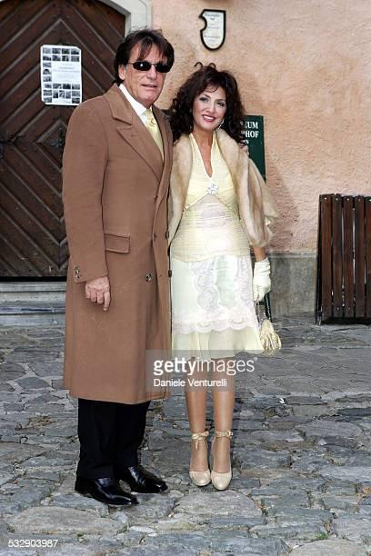 Marcella Bella and husband Mario Merello during Karl Hainz Grasser and Fiona Swarovski Wedding at Weissenkirchen in Weissenkirchen Wien Austria