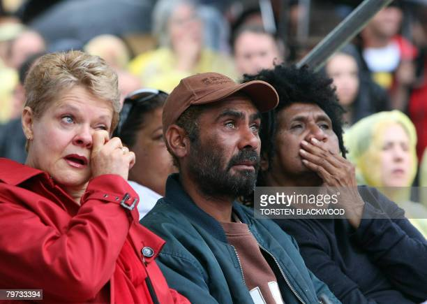 Marcelle Hoff Michael Kirby and Shireen Malamoo are overcome with emotion as they watch Australian Prime Minister Kevin Rudd on a large screen...