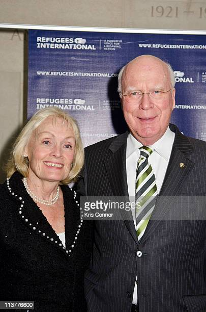 Marcelle Pomerleau and Patrick Leahy pose for a photo during the Refugees International's 32nd Anniversary Dinner at Andrew W Mellon Auditorium on...