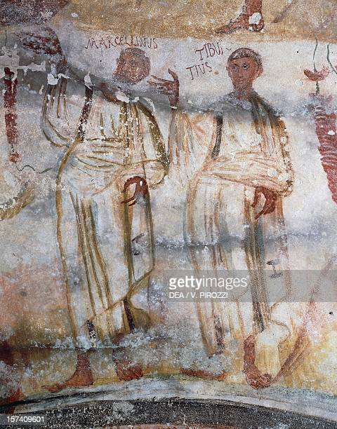 Marcellino and Tiburcio detail of Christ and the Holy Martyrs late 4th century fresco Catacomb of Saints Marcellinus and Peter Rome Italy 4th century