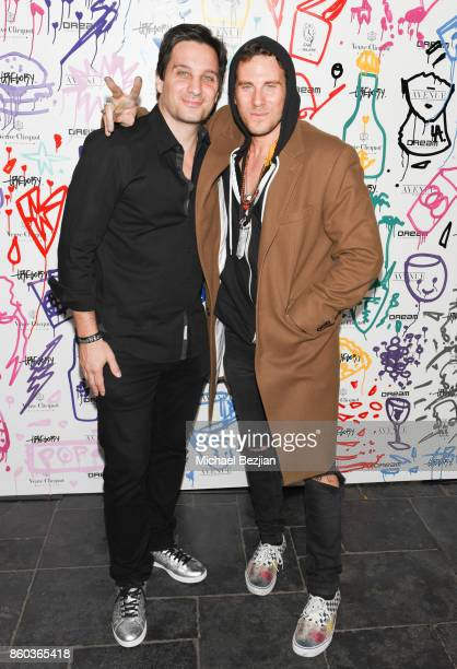 Marcello Cacioppo and Gregory Siff attend Gregory Siff Studios and 4AM Gallery Opening at Dream Hollywood on October 10 2017 in Los Angeles California