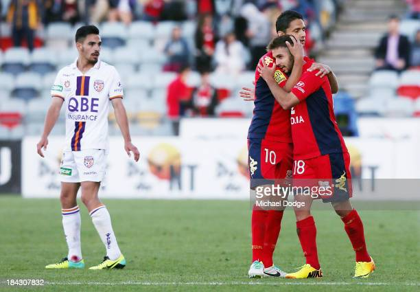 Marcello Carrusca and Michael Zullo of United celebrate their win during the round one ALeague match between Perth Glory and Adelaide United at...