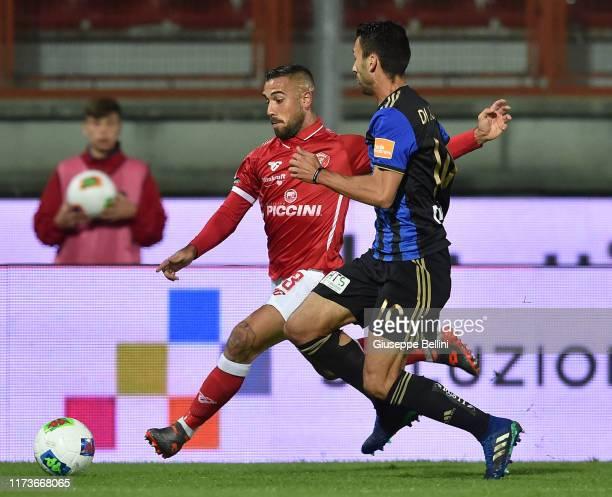 Marcello Falzerano of AC Perugia and Davide Di Quinzio of Pisa SC in action during the Serie B match between AC Perugia and Pisa SC at Stadio Renato...