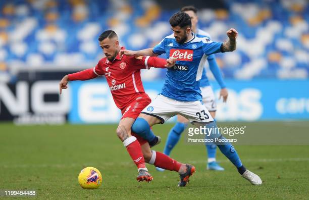Marcello Falzerano of Perugia vies with Elseid Hysaj of SSC Napoli during the Coppa Italia match between SSC Napoli and Perugia on January 14 2020 in...