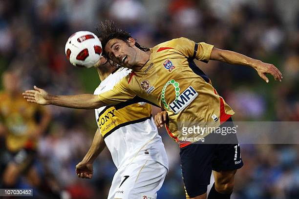 Marcello Fiorentini of the Jets heads the ball in front of Leo Bertos of the Phoenix during the round 15 A-League match between the Newcastle Jets...