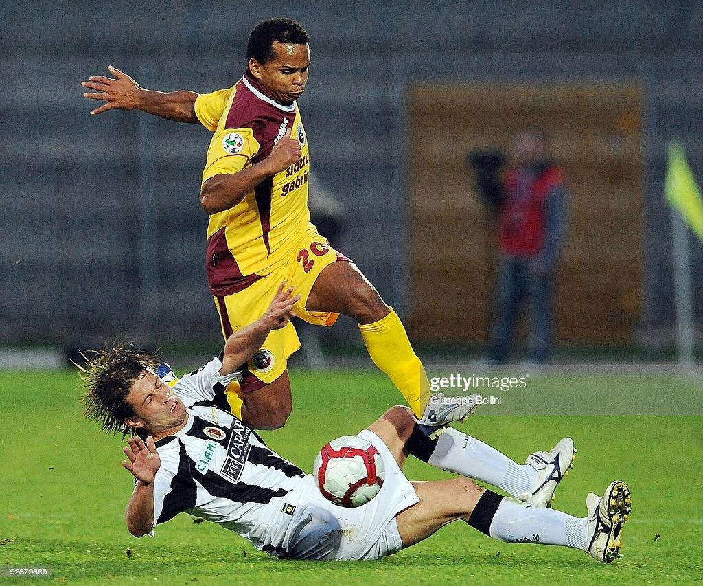 Marcello Gazzola of Ascoli Calcio tackles Santos Diego Oliveira (R) of AS Cittadella during the Serie B match between Ascoli Calcio and AS Cittadelle at Stadio Cino e Lillo Del Duca on November 7, 2009 in Ascoli Piceno, Italy.