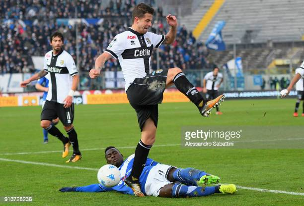 Marcello Gazzola of Parma Calcio competes for the ball whit Carlos Embalo of Brescia Calcio during the Serie B match between Brescia Calcio and Parma...