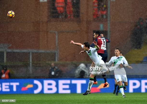 Marcello Gazzola of Sassuolo and Raffaele Palladino of Genoa jump for a header during the Serie A match between Genoa CFC and US Sassuolo at Stadio...