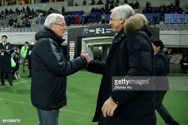 Marcello Lippi head coach of China shake hand with Vahid Halilhodzic head coach of Japan during the EAFF E1 Men's Football Championship between Japan...