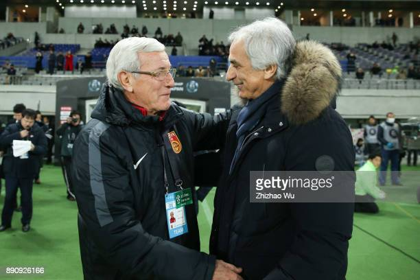 Marcello Lippi head coach of China shakes hand with Vahid Halilhodzic head coach of Japan during the EAFF E1 Men's Football Championship between...