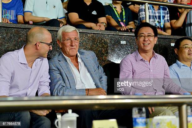 Marcello Lippi Manager of the China National Team and Xu Jiayin Chairman of Evergrande Group watch from the stand during the 28th round match of CSL...