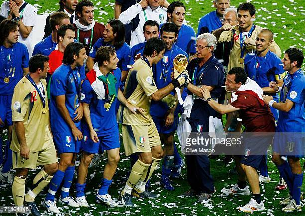 Marcello Lippi the coach of Italy and Goalkeeper Gianluigi Buffon hold the World Cup trophy following their team's victory in a penalty shootout at...