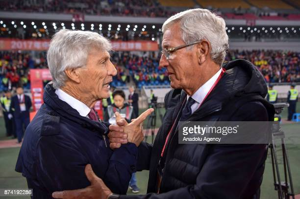 Marcello Lippi the head coach of China National Team shakes hands with Jose Pekerman the head coach of Colombia National Team during International...