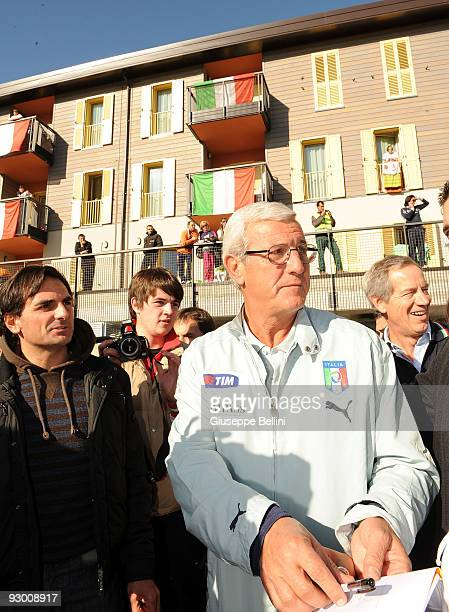 L'AQUILA ITALY NOVEMBER 12 Marcello Lippi the head coach of Italy and Guido Bertolaso during the Italy National Soccer Team visit to the earthquake...