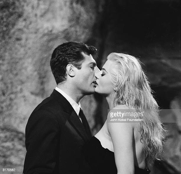 Marcello Mastroianni and Anita Ekberg share a screen kiss in 'La Dolce Vita' directed by Federico Fellini