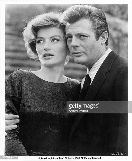 Marcello Mastroianni has his arm around Anouk Aimee in a scene from the film 'La Dolce Vita' 1960