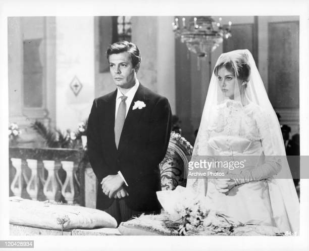 Marcello Mastroianni with actress at wedding in a scene from the film 'Casanova 70' 1965
